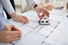 Close up of architects discussing house project. Architecture, construction business and people concept - close up of architects with blueprint discussing house stock images