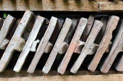 Close up on arranged bricks on a wood shelf. Royalty Free Stock Images