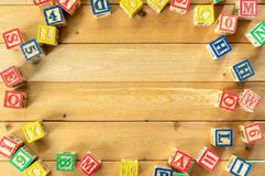 Close up arrangement of alphabet on wooden background. Stock Photography