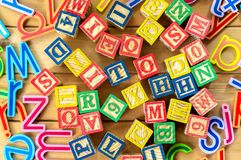 Close up arrangement of alphabet on wooden background Stock Image