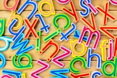 Close up arrangement of alphabet on wooden background Stock Images