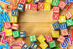 Close up arrangement of alphabet on wooden background Stock Photo
