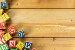 Close up arrangement of alphabet on wooden background. Stock Image