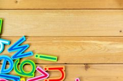 Close up arrangement of alphabet on wooden background Royalty Free Stock Image
