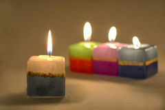 Close-up of an arrangement of burning candles . Stock Photography