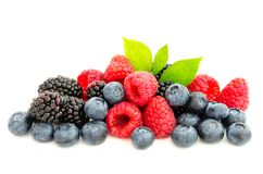 Studio shot mixed berries isolated on white. Close-up arrangement with mixed, assorted berries including blackberries, strawberry, blueberry and raspberries and Royalty Free Stock Photo