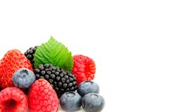 Studio shot mixed berries isolated on white. Close-up arrangement with mixed, assorted berries including blackberries, strawberry, blueberry and raspberries and Stock Image