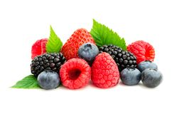 Studio shot mixed berries isolated on white. Close-up arrangement with mixed, assorted berries including blackberries, strawberry, blueberry and raspberries and Royalty Free Stock Images