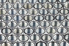 Close up array of metal nuts. Top side and close up array of metal nuts Stock Photo