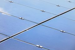 Close up array of thin film solar cells or amorphous silicon solar cells or photovoltaics in solar power plant. Turn up skyward absorb the sunlight from the sun stock image