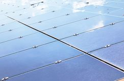 Close up array of thin film solar cells or amorphous silicon solar cells or photovoltaics in solar power plant. Turn up skyward absorb the sunlight from the sun stock images