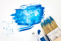 Close up Art brush and blue watercolor painted with white paper Royalty Free Stock Images