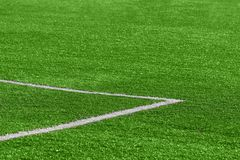 A close-up of an artificial green football turf with a corner ma stock photography
