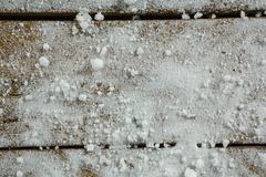 Close up of artificial snow. On wooden table Royalty Free Stock Images