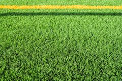 Close up of artificial turf of a soccer field stock photo