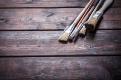 Close-up of Artist paint brushes. Over natural wooden background Stock Images