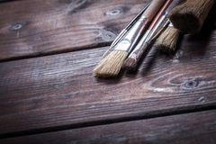 Close-up of Artist paint brushes. Over natural wooden background Royalty Free Stock Photo
