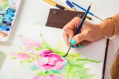 Close-up of the artist draws stock photos