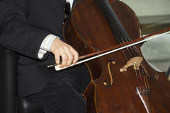 Close up Artist plays a bass in concert. Stock Photo