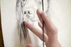 Close Up Of Artist Sitting At Easel Drawing Picture Of Dog In Charcoal royalty free stock images