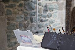 Close up of artistic brushes and plastic case Stock Photo
