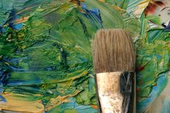 Artists palette. Close up of artists palette, oil paints and brush Royalty Free Stock Images