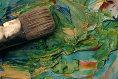 Artists palette. Close up of artists palette, oil paints and brush Stock Photos