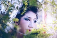 Close up of beautiful young woman posing in forest royalty free stock photo