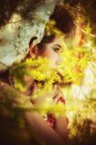 Close up of beautiful young woman posing in forest royalty free stock photography