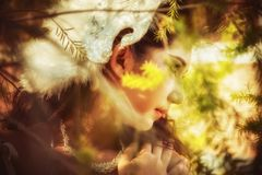 Close up of beautiful young woman posing in forest stock photos