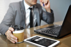 Close up Asian Businessman in grey suit holding cup of coffee. M Stock Image