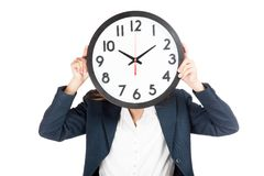 Close up Asian businesswoman with clock on face Stock Photo