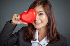 Close up Asian businesswoman close her eye with red heart Stock Photos