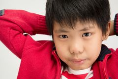 Close up of asian cute boy looking at camera stock images