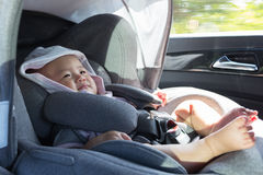 Close Up Asian cute newborn baby sitting in modern car seat. Royalty Free Stock Images