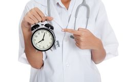 Close up Asian doctor point to a clock Stock Photo
