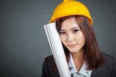 Close up Asian engineer girl hold a blueprint and smile Stock Photography