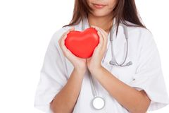Close up of Asian female doctor hold a red heart and Royalty Free Stock Photos