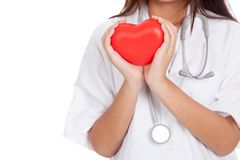 Close up of Asian female doctor hold a red heart and. Isolated on white background royalty free stock photos