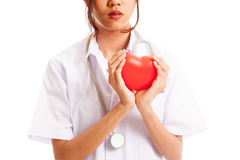 Close up of Asian female doctor hold a red heart and. Isolated on white background stock images