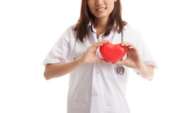 Close up of Asian female doctor hold a red heart and. Close up of Asian female doctor hold a red heart and isolated on white background royalty free stock photo