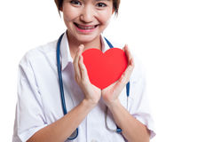 Close up of Asian female doctor hold a red heart and. Royalty Free Stock Photo