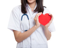 Close up of Asian female doctor hold a red heart and. Close up of Asian female doctor hold a red heart and isolated on white background royalty free stock photography