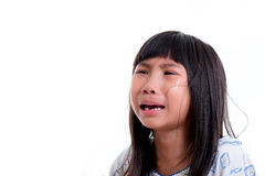 Close up Asian girl in pajamas crying on white. Stock Photos