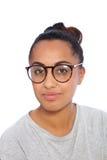 Close up Asian Indian Girl Wearing Eyeglasses. Close up Portrait of an Asian Indian Girl Wearing Casual Gray Shirt and Eyeglasses, Looking at the Camera on a Stock Photos