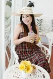 Close up Asian lady with coffee. Stock Photography