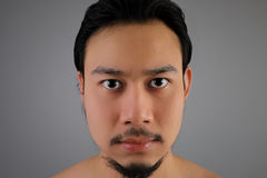 Close up of Asian man look straight. stock images
