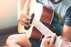 Close up of asian man playing guitar. Teenager hobby, Selective focus Royalty Free Stock Photography