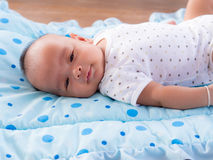Close up, asian newborn baby smiling. stock photos