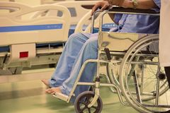Close up Asian patient in wheelchair sitting in hospital. Close up Asian patient in wheelchair sitting in hospital at Thailand royalty free stock photos